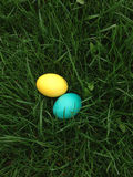 Colourful Easter eggs lie in a bright green fresh grass Stock Image