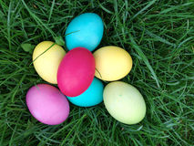 Colourful Easter eggs lie in a bright green fresh grass Stock Photo