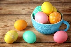 Colourful Easter eggs in a mug stock photo