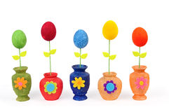 Colourful Easter eggs in vases Royalty Free Stock Photo