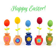 Colourful Easter eggs in vases. Isolated on the white Stock Image