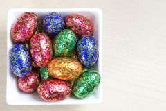 Colourful easter eggs in white bowl Stock Photo