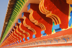 Colourful eaves. A roof eave from a temple in India.  It has many colours and is very bright Stock Images