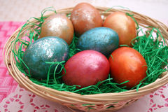 Colourful eggs. Some colourful eggs in a basket stock photo