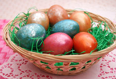 Colourful eggs. Some colourful eggs in a basket royalty free stock photo