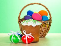 Colourful eggs, basket and Easter Stock Photo