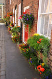 Colourful English floral village of Croston with flower baskets. Stock Image