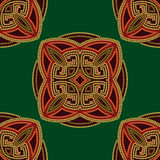 Colourful ethnic seamless pattern background in green and burgundy, orange colors Royalty Free Stock Image