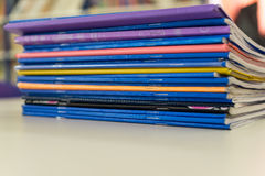 Colourful exercise books. On a white table stock image