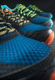 Colourful exercise trainers / running shoes. Two pairs of colourful exercise trainers / running shoes inside a gym stock photos
