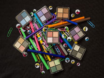 Colourful Eyes. Make up Products with Colourful Pens, Plastic Eyes and Colourful Paperclips Stock Photo