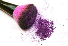 Colourful eyeshadow powder and make-up brush Royalty Free Stock Images