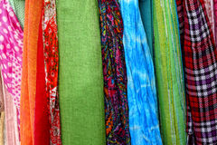 Colourful fabric. Colourful pieces of material hanging one after another Royalty Free Stock Photos