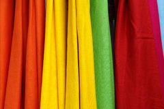 Colourful fabric. Colourful pieces of material hanging one after another Stock Photos