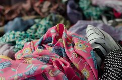 Colourful fabric on sale in Turkish Market. Colourful fabric on sale at Turkish Market in Bodrum, South Turkey. Mixture of scarves and textiles Royalty Free Stock Photo