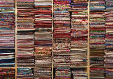 Colourful fabric, textile and silk on wooden shelf in fabric store. Colourful fabric, textile and silk on wood shelf in fabric store royalty free stock image
