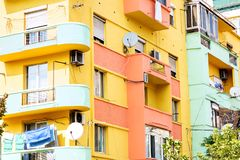 Colourful communism building. Colourful facade of a building from communism time renovated in the center of Tirana, Albanian capital Royalty Free Stock Image