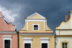 Colourful facade of houses in Trebon. Colourful facade of old houses in Trebon, Czech republic. Dramatic sky at background Royalty Free Stock Images