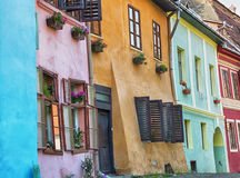 Colourful facades in Sighisoara, Romania. Royalty Free Stock Images