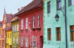 Colourful facades in Sighisoara, Romania. Stock Photo