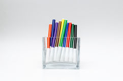 Colourful felt pens bright vivid. Felt pens in the row in see-thru container stock images