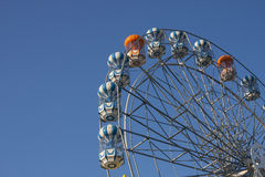 Ferris wheel and blue sky. A colourful ferris wheel against a deep blue sky Stock Images