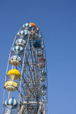 Ferris wheel and blue sky. A colourful ferris wheel against a deep blue sky stock photography