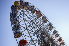 Colourful ferris wheel. A colourful ferris wheel against a deep blue sky Royalty Free Stock Image