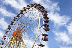 A colourful ferris wheel against a deep blue sky Royalty Free Stock Image