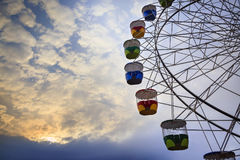 Colourful ferris wheel carriages Stock Photos