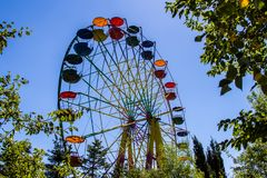 Colourful ferris wheel, front view, daytime, park, clear sky, beautiful weather Stock Image
