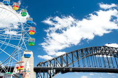 Colourful Ferris Wheel and Harbour Bridge Royalty Free Stock Photo