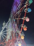 Colourful ferris wheel in the light of the night in Tokyo Stock Photos