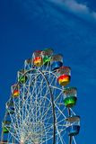 Colourful ferris wheel and sky Stock Photos