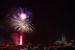 Colourful firework in front of the cathedral of Cologne Stock Photos