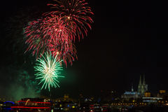 Colourful firework in front of the cathedral of Cologne Royalty Free Stock Photo