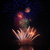 Colourful Fireworks. Multiple fireworks in a composition in shades of red, blue and green royalty free stock images