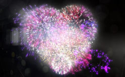 Colourful fireworks exploding on black background Stock Images