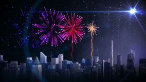 Colourful fireworks exploding over city stock footage