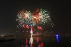 Colourful fireworks exploding over a dark night sky. In Abu Dhabi, UAE Stock Images