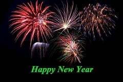 Colourful New Year fireworks. Colourful fireworks with happy new year text stock images