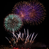 Colourful fireworks isolated in dark background close up with the place for text in Malta Stock Photo