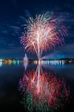 Colourful fireworks with a reflection on the water for celebrati Royalty Free Stock Photo