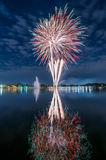 Colourful fireworks with a reflection on the water for celebrati Stock Image