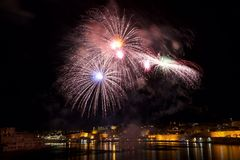 Colourful fireworks in Valletta, Malta, fireworks festival 2015 in Malta, fireworks in Valletta isolated in dark background with t Royalty Free Stock Image