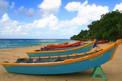 Colourful fisherman boats. Many colorful fishermans boats sitting on the beach Royalty Free Stock Photos