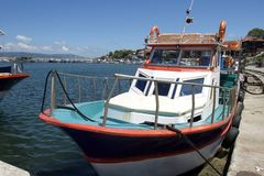 Colourful fishing boat at the pier Stock Photo