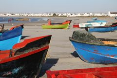 Colourful fishing boats on the beach at Paternoster, small fishing village with gourmet restaurants on west coast of South Africa. Colourful fishing boats on the stock image