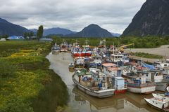 Fishing boats in Puerto Aysen, Patagonia, Chile. Colourful fishing boats in a creek in the coastal town of Puerto Aysen in northern Patagonia, Chile royalty free stock photography