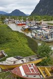 Fishing boats in Puerto Aysen, Patagonia, Chile. Colourful fishing boats in a creek in the coastal town of Puerto Aysen in northern Patagonia, Chile stock images
